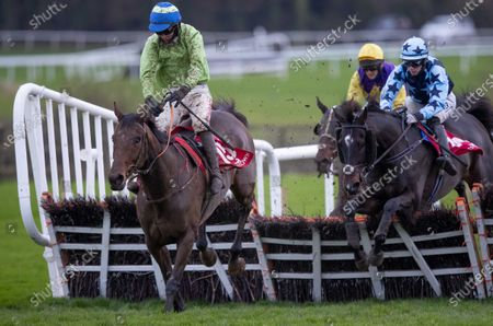 Danny Mullins on Exciting Oscar clears the last to win The Barry Geraghty`s Autobiography `True Colours` Handicap Hurdle