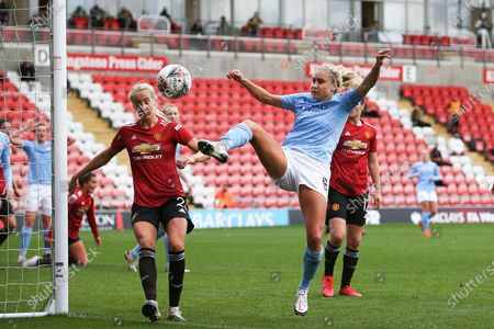 Manchester City defender Steph Houghton (6) shoots on goal during the FA Women's Super League match between Manchester United Women and Manchester City Women at Leigh Sports Village, Leigh