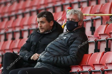 Steve Bruce Newcastle United manager with his son Alex Bruce during the EFL Sky Bet League 1 match between Crewe Alexandra and Peterborough United at Alexandra Stadium, Crewe