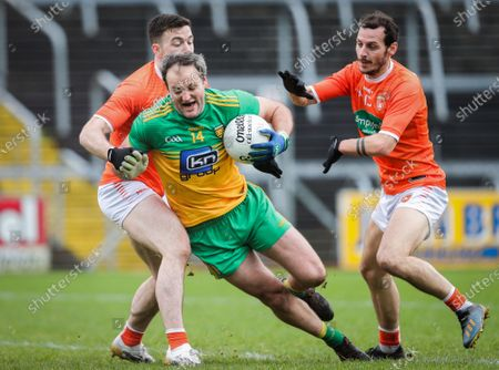 Stock Photo of Donegal vs Armagh. Donegal's Michael Murphy with Aidan Forker and Jamie Clarke of Armagh