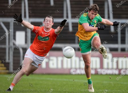 Stock Photo of Donegal vs Armagh. Donegal's Peadar Mogan scores a goal despite the efforts of Ryan Kennedy of Armagh