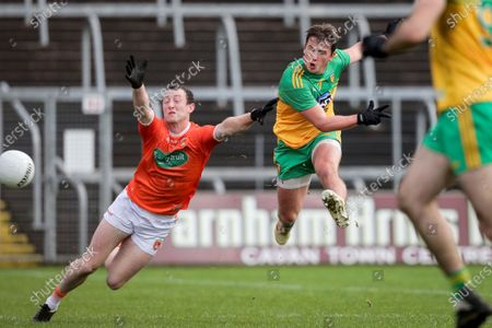 Donegal vs Armagh. Donegal's Peadar Mogan scores a goal despite the efforts of Ryan Kennedy of Armagh