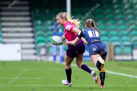 Olivia Jones of Loughborough Lightning is caught by Vicky Laflin of Worcester Warriors Women
