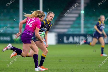 Vicky Laflin of Worcester Warriors Women tracks the run of Olivia Jones of Loughborough Lightning