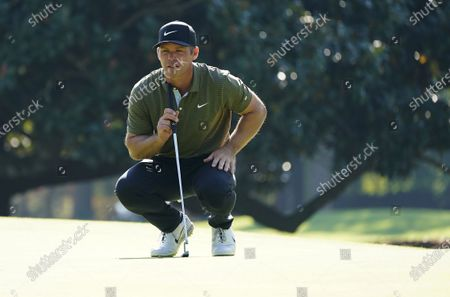 Paul Casey of England lines up his putt on the first hole during the third round of the 2020 Masters Tournament at the Augusta National Golf Club in Augusta, Georgia, USA, 14 November 2020. After being delayed seven months by the coronavirus pandemic, the 2020 Masters Tournament is being held without patrons 12 November through 15 November.