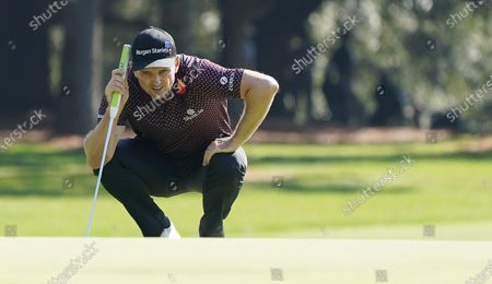Stock Image of Justin Rose of England lines up his putt on the first hole during the third round of the 2020 Masters Tournament at the Augusta National Golf Club in Augusta, Georgia, USA, 14 November 2020. After being delayed seven months by the coronavirus pandemic, the 2020 Masters Tournament is being held without patrons 12 November through 15 November.