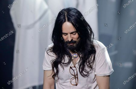"Stock Picture of Designer Alessandro Michele acknowledges the applause at the end of Gucci's Fall/Winter 2020/2021 collection, presented in Milan, Italy. Gucci creative director Alessandro Michele teamed up with film director Gus Van Sant to create a seven-part mini-series revealing Gucci's latest collection, dubbed ""Ouverture"