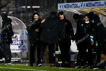 Fleetwood Town manager Joey Barton (right) celebrates after his side go 0-2 up