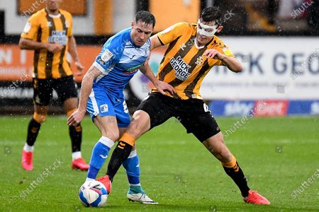 Stock Photo of Cambridge United midfielder Paul Digby (4) battles for possession  with Barrow AFC midfielder Mike Jones (8) during the EFL Sky Bet League 2 match between Cambridge United and Barrow at the Cambs Glass Stadium, Cambridge