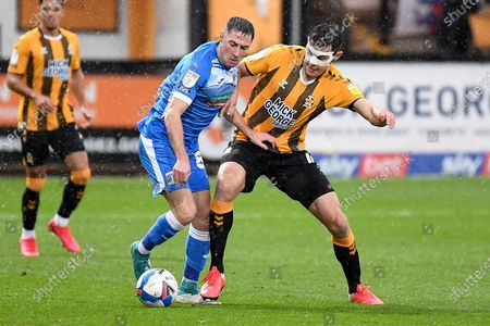 Barrow AFC midfielder Mike Jones (8) battles for possession  with Cambridge United midfielder Paul Digby (4) during the EFL Sky Bet League 2 match between Cambridge United and Barrow at the Cambs Glass Stadium, Cambridge