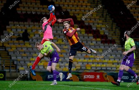 Bradford City defender Tyler French (15) challenges in the air during the EFL Sky Bet League 2 match between Bradford City and Exeter City at the Utilita Energy Stadium, Bradford