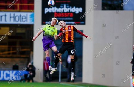 Stock Photo of Exeter City defender Jack Sparkes (3) challenges with Bradford City defender Tyler French (15)  during the EFL Sky Bet League 2 match between Bradford City and Exeter City at the Utilita Energy Stadium, Bradford
