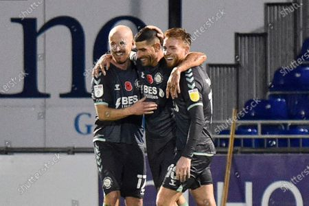 Goal 1-4 - Ched Evans (9) of Fleetwood Town celebrates after scoring from the penalty spot with Paddy Madden (17) of Fleetwood Town and Callum Camps (10) of Fleetwood Town during the EFL Sky Bet League 1 match between Bristol Rovers and Fleetwood Town at the Memorial Stadium, Bristol