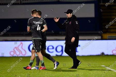 Fleetwood Town manager Joey Barton  congratulates Callum Connolly (4) of Fleetwood Town at full time during the EFL Sky Bet League 1 match between Bristol Rovers and Fleetwood Town at the Memorial Stadium, Bristol