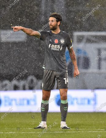 Stock Photo of Charlie Mulgrew (14) of Fleetwood Town gestures during the EFL Sky Bet League 1 match between Bristol Rovers and Fleetwood Town at the Memorial Stadium, Bristol