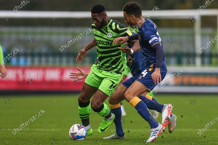 Forest Green Rovers Jamille Matt(14) holds off James Perch (14) of Mansfield Town during the EFL Sky Bet League 2 match between Forest Green Rovers and Mansfield Town at the New Lawn, Forest Green