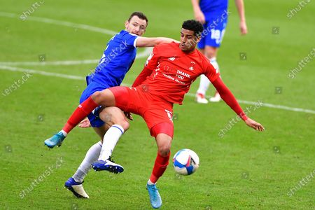 Colchester United's Thomas Smith (5) Leyton Orient's Louis Dennis(17) battles for possession during the EFL Sky Bet League 2 match between Colchester United and Leyton Orient at the JobServe Community Stadium, Colchester