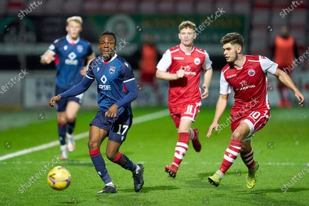 Stock Photo of Regan Charles-Cook of Ross County sets off on an attack closely watched by Jack Leitch of Stirling Albion