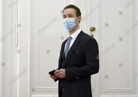 Austrian Finance Minister Gernot Bluemel listens Austrian to Chancellor Sebastian Kurz speakin at the press conference at the Austrian Chancellery in Vienna, Austria, 14 November 2020. The Austrian government announces to tighten and extend the current lockdown to slow down the ongoing pandemic of the COVID-19 disease caused by the SARS-CoV-2 coronavirus. Stricter measures include restrictions concerning the movement of individuals and the closing of all non essential businesses and educational institutions.