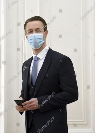 Stock Image of Austrian Finance Minister Gernot Bluemel listens Austrian to Chancellor Sebastian Kurz speakin at the press conference at the Austrian Chancellery in Vienna, Austria, 14 November 2020. The Austrian government announces to tighten and extend the current lockdown to slow down the ongoing pandemic of the COVID-19 disease caused by the SARS-CoV-2 coronavirus. Stricter measures include restrictions concerning the movement of individuals and the closing of all non essential businesses and educational institutions.
