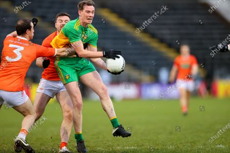 Stock Image of Ulster GAA Senior Football Championship Semi-Final, Kingspan Breffni Park, Creighan, Co. Cavan 14/11/2020. Donegal vs Armagh. Donegal's Ciaran Thompson tackled by Ryan Kennedy of Armagh