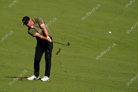 Paul Casey, of England, hits on the second fairway during the third round of the Masters golf tournament, in Augusta, Ga