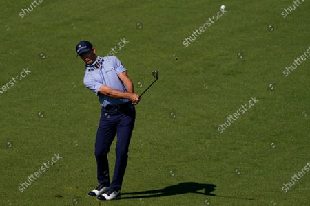 Billy Horschel chips to the second green during the third round of the Masters golf tournament, in Augusta, Ga