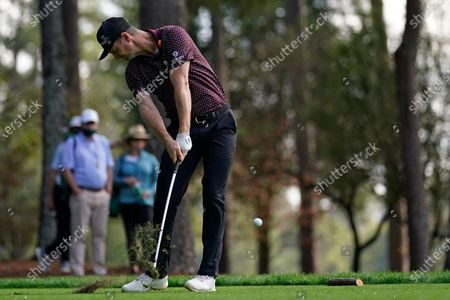 Justin Rose, of England, tees off on the fourth hole during the third round of the Masters golf tournament, in Augusta, Ga