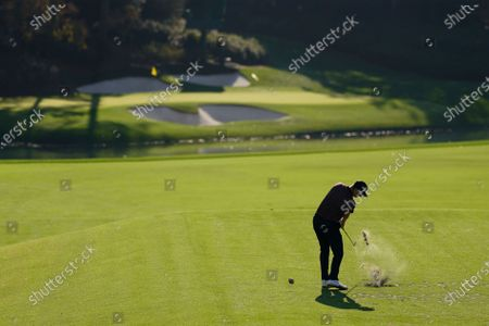 Stock Picture of Justin Rose, of England, tees off on the 12th hole during the third round of the Masters golf tournament, in Augusta, Ga