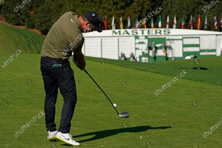 Paul Casey, of England, tees off on the first hole during the third round of the Masters golf tournament, in Augusta, Ga