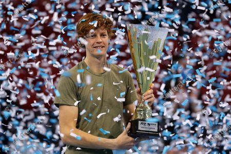 Italy's Jannik Sinner holds the winner's trophy after winning his final match against Canada's Vasek Pospisil during the Sofia Open ATP 250 tennis tournament.