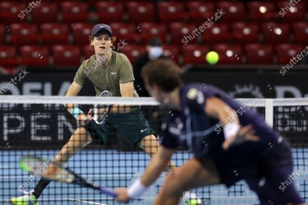Italy's Jannik Sinner (L) in action during his final match against Canada's Vasek Pospisil during the Sofia Open ATP 250 tennis tournament.