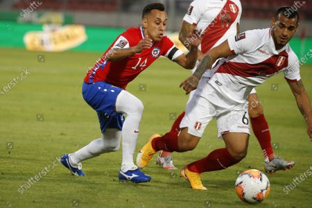 Fabian Orellana of Chile and Miguel Trauco of Peru; National Stadium of Santiago, Santiago, Chile; World Cup 2020 Football qualification, Chile versus Peru.