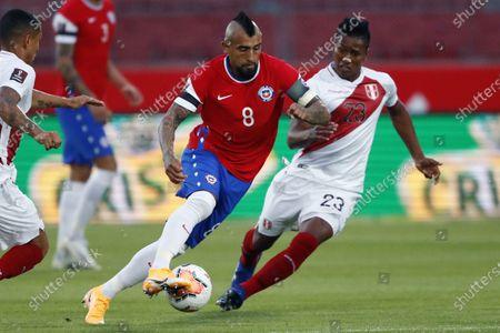 Arturo Vidal of Chile goes past Pedro Aquino of Peru; National Stadium of Santiago, Santiago, Chile; World Cup 2020 Football qualification, Chile versus Peru.