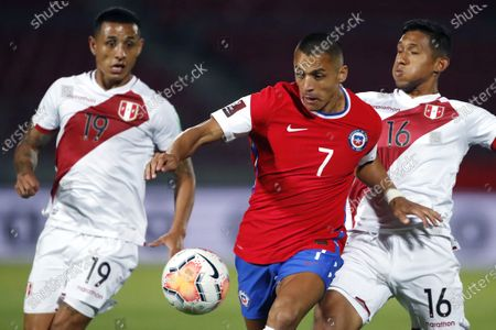 Alexis Sanchez of Chile is challenged by Yoshimar Yotun and Cristofer Gonzales of Peru; National Stadium of Santiago, Santiago, Chile; World Cup 2020 Football qualification, Chile versus Peru.