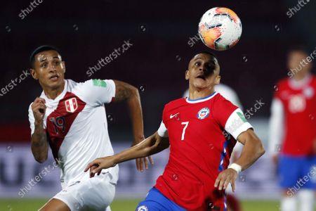 Alexis Sanchez of Chile turns away from Yoshimar Yotun of Peru; National Stadium of Santiago, Santiago, Chile; World Cup 2020 Football qualification, Chile versus Peru.
