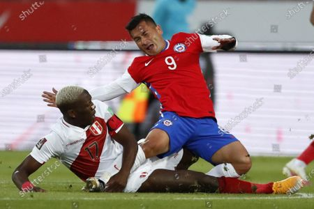 Jean Meneses of Chile is brought down and fouled by Luis Advincula of Peru; National Stadium of Santiago, Santiago, Chile; World Cup 2020 Football qualification, Chile versus Peru.