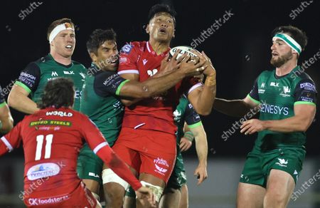 Connacht vs Scarlets. Connacht's Jarrad Butler and Tom Daly with Sam Lousi of Scarlets