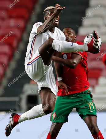 France's Paul Pogba, left, challenges Portugal's William Carvalho during the UEFA Nations League soccer match between Portugal and France at the Luz stadium in Lisbon
