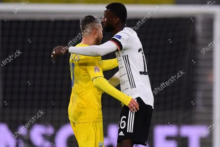 Ukraine's Marlos (L) and Germany's Antonio Ruediger (R) react after the UEFA Nations League soccer match between Germany and Ukraine in Leipzig, Germany, 14 November 2020.