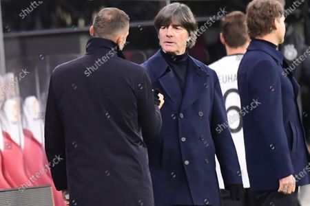 Stock Picture of Ukraine's head coach Andriy Shevchenko (L) shakes hands with Germany's head coach Joachim Loew (C) after the UEFA Nations League soccer match between Germany and Ukraine in Leipzig, Germany, 14 November 2020.
