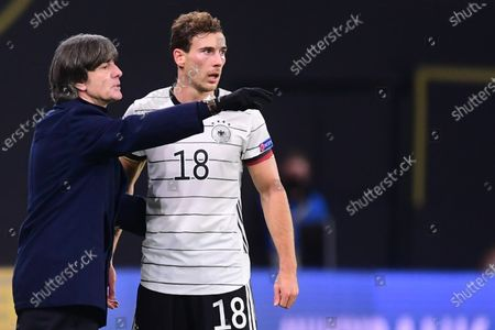 Germany's head coach Joachim Loew (L) gives instructions to Leon Goretzka (R) during the UEFA Nations League soccer match between Germany and Ukraine in Leipzig, Germany, 14 November 2020.