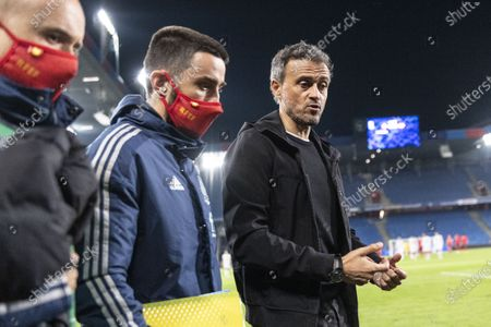 Spain's head coach Luis Enrique (R) and assistant coach Rafel Pol (C) react at half time of the UEFA Nations League soccer match between Switzerland and Spain at St. Jakob-Park stadium in Basel, Switzerland, 14 November 2020.