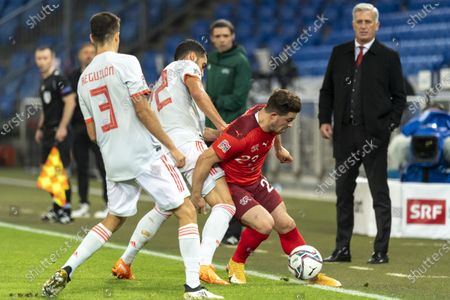 Switzerland's Xherdan Shaqiri (2-R) in action against Spanish players Sergio Reguilon (L) and Mikel Merino (2-L) during the UEFA Nations League soccer match between Switzerland and Spain at St. Jakob-Park stadium in Basel, Switzerland, 14 November 2020.