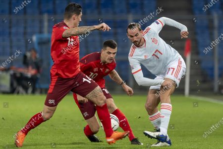 (L-R) Switzerland's Steven Zuber and Granit Xhaka against Spain's Fabian Ruiz, during the UEFA Nations League group 4 soccer match between Switzerland and Spain at the St. Jakob-Park stadium in Basel, Switzerland, 14 November 2020.