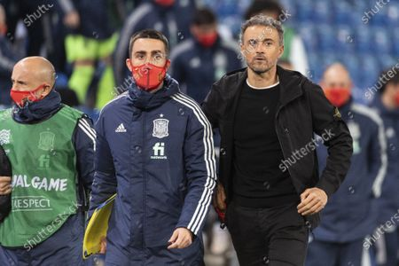 Spain's head coach Luis Enrique (R) and team members react at half time of the UEFA Nations League soccer match between Switzerland and Spain at St. Jakob-Park stadium in Basel, Switzerland, 14 November 2020.
