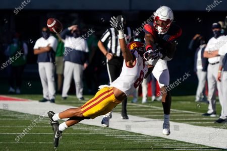 Southern California cornerback Chris Steele (8) knocks the ball away from Arizona wide receiver Boobie Curry (2) in the second half during an NCAA college football game, in Tucson, Ariz. Southern California won 34-30
