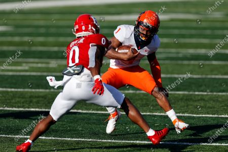 Illinois quarterback Isaiah Williams (1) rushes past Rutgers defensive back Christian Izien during the first half of an NCAA college football game, in Piscataway, N.J
