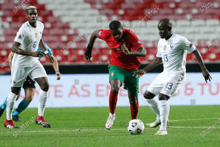 Portugal's Cristiano William Carvalho (C) in action against France's N´Golo Kante (R) during their UEFA Nations League group 3 soccer match held at Luz Stadium, in Lisbon, Portugal, 14 November 2020.