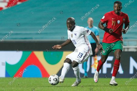 Portugal's William Carvalho (R) in action against France's N´Golo Kante (L) during their UEFA Nations League group 3 soccer match held at Luz Stadium, in Lisbon, Portugal, 14 November 2020.